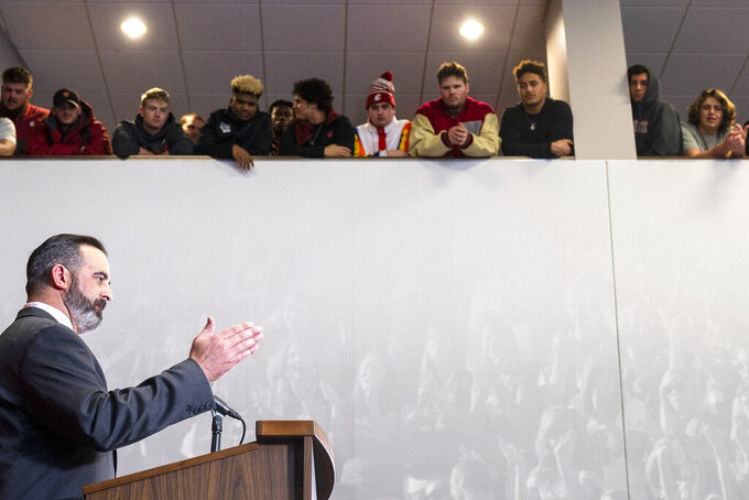 New Washington State football coach Nick Rolovich speaks during a press conference as players from the team look on from a balcony Thursday, Jan. 16, 2020, in Pullman, Wash. (Pete Caster/Lewiston Tribune via AP)