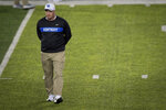 Kentucky head coach Mark Stoops observes warmups before an NCAA college football game against Vanderbilt in Lexington, Ky., Saturday, Oct. 20, 2018. (AP Photo/Bryan Woolston)