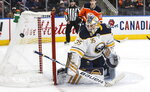 Buffalo Sabres goalie Linus Ullmark (35) makes the save against the Edmonton Oilers during the second period of an NHL hockey game, Sunday, Dec. 8, 2019 in Edmonton, Alberta. (Jason Franson/The Canadian Press via AP)