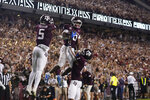 Texas A&M wide receiver Ainias Smith (0) celebrates with wide receivers Demond Demas (1) and Jalen Preston (5) after scoring a touchdown against Alabama during the second half of an NCAA college football game Saturday, Oct. 9, 2021, in College Station, Texas. (AP Photo/Sam Craft)