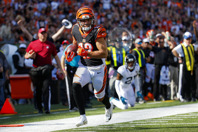 Cincinnati Bengals wide receiver Alex Erickson (12) runs the ball after breaking away from Jacksonville Jaguars cornerback A.J. Bouye in the first half of an NFL football game, Sunday, Oct. 20, 2019, in Cincinnati. (AP Photo/Frank Victores)