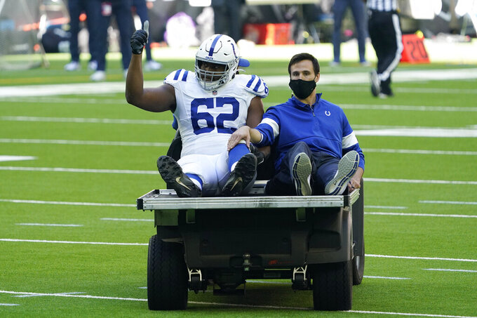 Indianapolis Colts offensive tackle Le'Raven Clark (62) is taken off of the field with a cart after an injury during the first half of an NFL football game against the Houston Texans, Sunday, Dec. 6, 2020, in Houston. (AP Photo/David J. Phillip)
