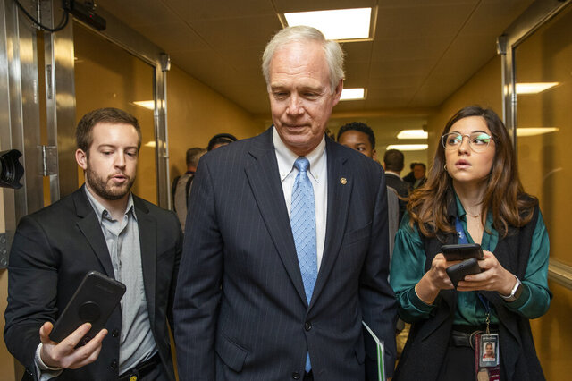 Sen. Ron Johnson, R-Wis., speaks to reporters as he arrives at the Capitol in Washington, Monday, Jan. 27, 2020, during the impeachment trial of President Donald Trump on charges of abuse of power and obstruction of Congress. (AP Photo/Manuel Balce Ceneta)
