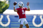 Indianapolis Colts quarterback Jacob Eason throws during practice at the NFL team's football training camp in Westfield, Ind., Monday, Aug. 2, 2021. (AP Photo/Michael Conroy)