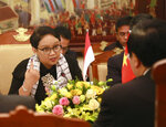 Indonesian Foreign Minister Retno Marsudi, left, speaks during a talk with her Vietnamese counterpart Pham Binh Minh, in Hanoi, Vietnam, Tuesday, April 17, 2018. The two countries pledge to work together to resolve the fishing violations in the South China Sea as the they seek to boost their bilateral trade. (AP Photo/Tran Van Minh)