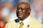 FILE - In this Sept. 26, 2010 file photo, former Denver Broncos running back Floyd Little speaks during the halftime of an NFL football game between the Indianapolis Colts and the Denver Broncos n Denver. Little, the Hall of Fame running back who starred at Syracuse and for the Denver Broncos, has died.  The Pro Football Hall of Fame said he died Friday, Jan. 1, 2021.    (AP Photo/ Jack Dempsey, File )