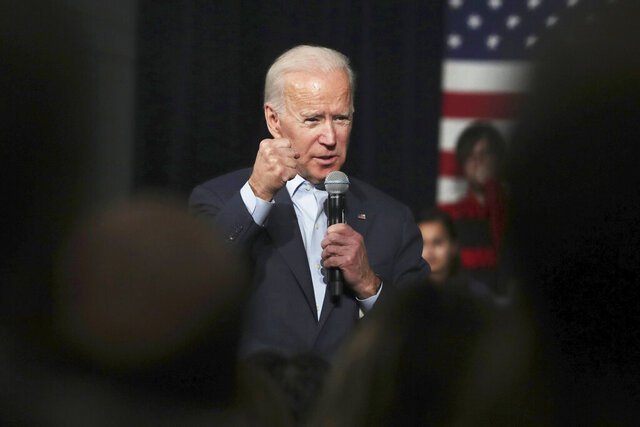 FILE - In this Monday, Dec. 30, 2019 file photo, Democratic presidential candidate former Vice President Joe Biden addresses a gathering during a campaign stop in Exeter, N.H. A video of Biden that was selectively edited to suggest he made racist remarks during a recent speech was making the rounds Thursday, Jan, 2, 2020 on social media, raking in more than a million views on one tweet alone. (AP Photo/Charles Krupa)