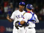 Texas Rangers relief pitcher Jose Leclerc, left, is congratulated by Texas Rangers catcher Isiah Kiner-Falefa after the Rangers defeated the Los Angeles Angels 12-7 in a baseball game, Monday, April 15, 2019, in Arlington, Texas. (AP Photo/Michael Ainsworth)