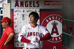 Los Angeles Angels designated hitter Shohei Ohtani (17) takes off his gloves in the dugout after striking out swinging during the sixth inning of a baseball game against the New York Yankees Wednesday, Sep. 1, 2021, in Anaheim, Calif. (AP Photo/Ashley Landis)