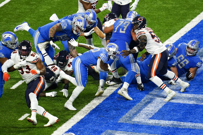Detroit Lions running back D'Andre Swift (32) scores on a one-yard touchdown run against the Chicago Bears in the first half of an NFL football game in Detroit, Sunday, Sept. 13, 2020. (AP Photo/Paul Sancya)
