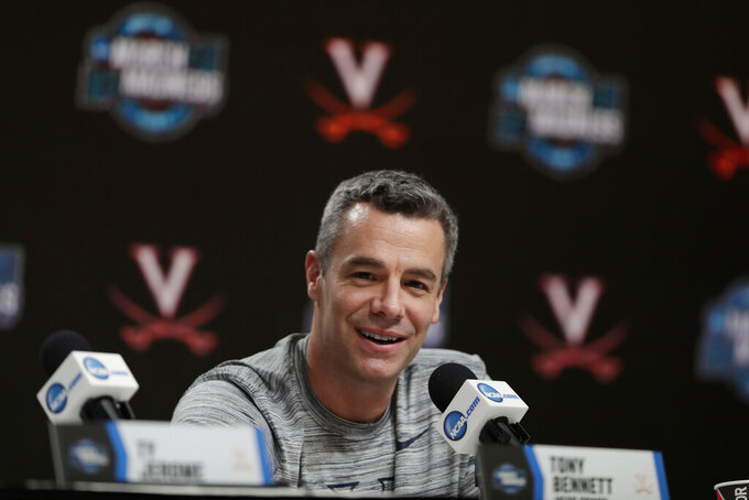 Virginia head coach Tony Bennett speaks during a news conference for the men's NCAA Tournament college basketball South Regional final game, Friday, March 29, 2019, in Louisville, Ky. (AP Photo/Michael Conroy)
