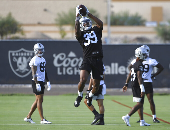 Las Vegas Raiders corner back Nate Hobbs (39) makes a catch during an NFL football practice Wednesday, July 28, 2021, in Henderson, Nev. (AP Photo/David Becker)