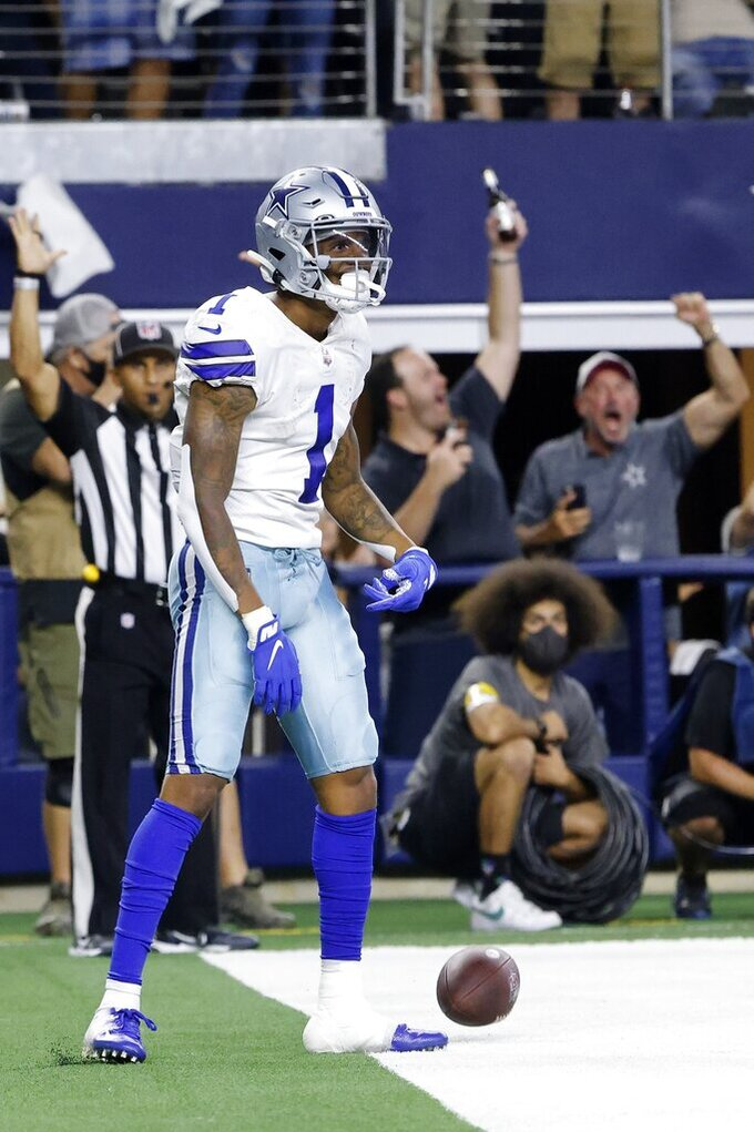 Dallas Cowboys wide receiver Cedrick Wilson (1) celebrates his touchdown catch in the second half of an NFL football game against the Philadelphia Eagles in Arlington, Texas, Monday, Sept. 27, 2021. (AP Photo/Michael Ainsworth)
