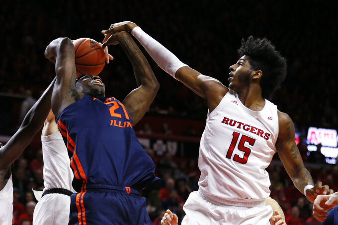 Illinois center Kofi Cockburn (21) is fouled by Rutgers center Myles Johnson (15) during the first half of an NCAA college basketball game Saturday, Feb. 15, 2020, in Piscataway, N.J. (AP Photo/Adam Hunger)