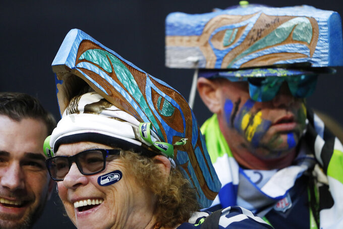 Seattle Seahawks fans watch teams warm up before the first half of an NFL football game between the Atlanta Falcons and the Seattle Seahawks, Sunday, Oct. 27, 2019, in Atlanta. (AP Photo/John Bazemore)