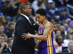LSU interim coach Tony Benford, left, greets guard Tremont Waters late in the team's NCAA men's college basketball tournament East Region semifinal against Michigan State in Washington, Friday, March 29, 2019. Michigan State won 80-63. (AP Photo/Alex Brandon)