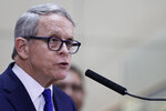 Ohio Governor Mike DeWine gives an update at MetroHealth Medical Center on the state's preparedness and education efforts to limit the potential spread of a new virus which caused a disease called COVID-19, Thursday, Feb. 27, 2020, in Cleveland. (AP Photo/Tony Dejak)