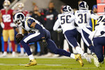 Los Angeles Rams cornerback Jalen Ramsey runs after intercepting a San Francisco 49ers pass during the first half of an NFL football game in Santa Clara, Calif., Saturday, Dec. 21, 2019. (AP Photo/Tony Avelar)