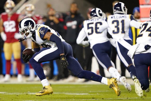 Los Angeles Rams cornerback Jalen Ramsey runs after intercepting a San Francisco 49ers pass during the first half of an NFL football game in Santa Clara, Calif., Saturday, Dec. 21, 2019. (AP Photo/Tony Avelar)