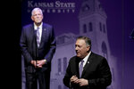 Secretary of State Mike Pompeo answers a question from an audience member while Kansas State University President Richard Myers looks on after Pompeo gave a speech at the London Lecture series Friday, Sept. 6, 2019, in Manhattan, Kan. (AP Photo/Charlie Riedel)
