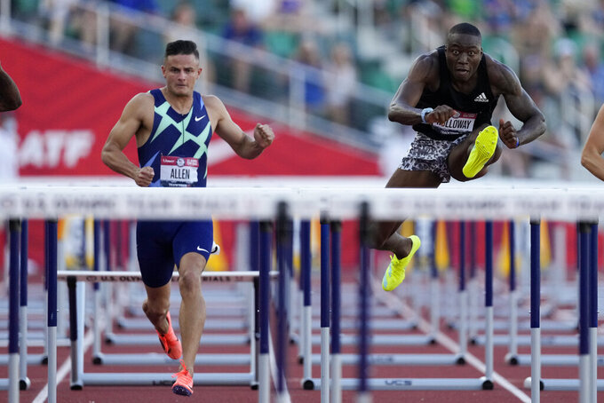 Grant Holloway, right, wins the final in the men's 110-meter hurdles ahead of Devon Allen at the U.S. Olympic Track and Field Trials Saturday, June 26, 2021, in Eugene, Ore. (AP Photo/Ashley Landis)