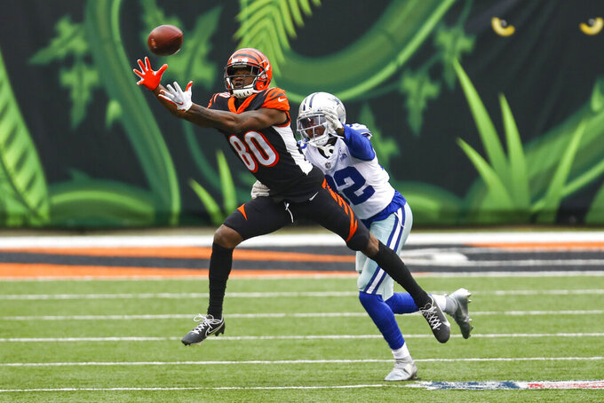 Cincinnati Bengals wide receiver Mike Thomas (80) makes a catch in front of Dallas Cowboys cornerback Saivon Smith (32) in the first half of an NFL football game in Cincinnati, Sunday, Dec. 13, 2020. (AP Photo/Aaron Doster)