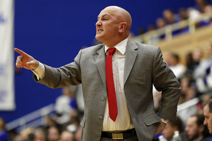 Stony Brook head coach Geno Ford directs his team against Seton Hall during the first half of an NCAA college basketball game Saturday, Nov. 9, 2019, in South Orange, N.J. Seton Hall won 74-57. (AP Photo/Adam Hunger)