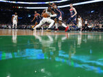 Boston Celtics' Jaylen Brown tries to get past Washington Wizards' Bradley Beal during the second quarter of an NBA basketball game Wednesday, Nov. 13, 2019, in Boston. (AP Photo/Winslow Townson)