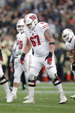 Wisconsin offensive lineman Jon Dietzen (67) during the first half of an NCAA college football game against Purdue in West Lafayette, Ind., Saturday, Nov. 17, 2018. Wisconsin has welcomed back Dietzen and lost safety Reggie Pearson as it resumes practice to prepare for the pandemic-delayed season. The Badgers released a roster Wednesday, Sept. 23, 2020 that didn't include Pearson but added Dietzen, who had announced in February 2019 that he was stepping away from football due to injuries. (AP Photo/Michael Conroy)