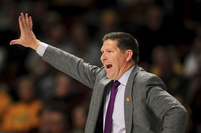 Clemson head coach Brad Brownell calls a play against Minnesota in the second half during an NCAA college basketball game Monday, Dec. 2, 2019, in Minneapolis. (AP Photo/Andy Clayton-King)