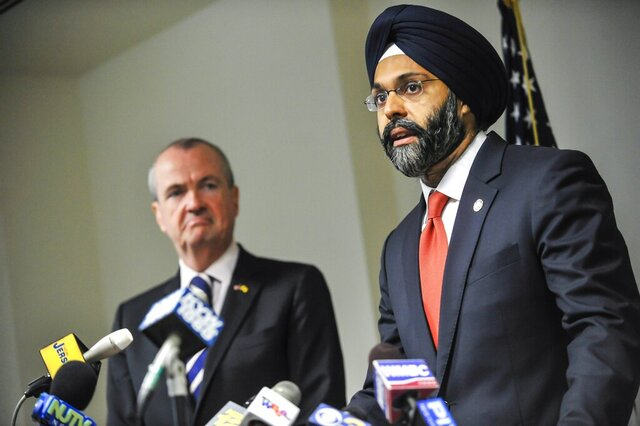 FILE - In this Dec. 12, 2017 file photo, Bergen County Prosecutor Gurbir Grewal addresses the media after Gov.-elect Phil Murphy nominated him for attorney general in Trenton, N.J. U.S. Attorney General William Barr announced on Monday, Feb. 10, 2020, that the U.S. was taking New Jersey to court over a 2018 policy issued by Grewal that called for state and local police to limit how much they help federal officials enforce immigration laws. (Jeffrey Granit/NJ Advance Media via AP, File)