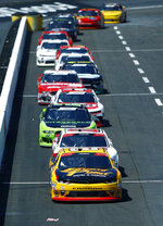 Daniel Hemric (21) leads Cole Custer and the rest of the field down pit road after the stage of a NASCAR Xfinity Series auto race on Saturday, April 14, 2018 in Bristol, Tenn. (AP Photo/Wade Payne)