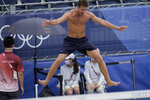 Christian Sandlie Sorum, of Norway, jumps as he celebrates winning a men's beach volleyball Gold Medal match against the Russian Olympic Committee at the 2020 Summer Olympics, Saturday, Aug. 7, 2021, in Tokyo, Japan. (AP Photo/Petros Giannakouris)