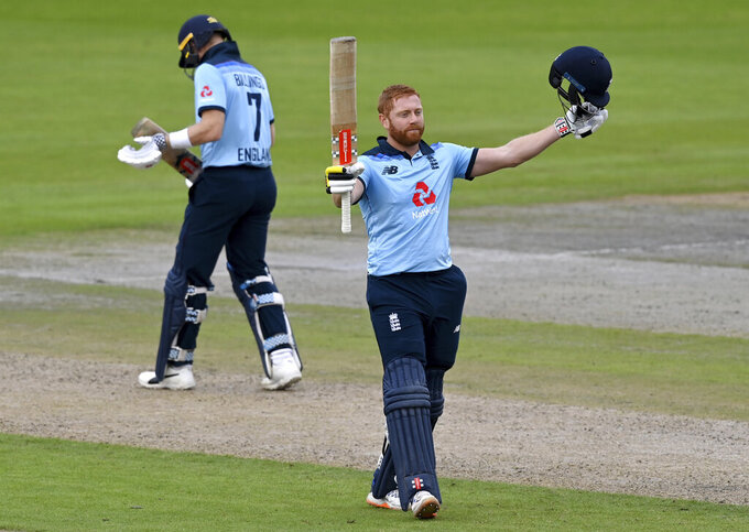 England's Jonny Bairstow, right, celebrates scoring a century during the third ODI cricket match between England and Australia, at Old Trafford in Manchester, England, Wednesday, Sept. 16, 2020. (Shaun Botterill/Pool via AP)
