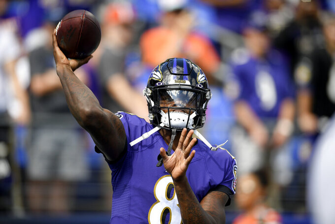 Baltimore Ravens quarterback Lamar Jackson works out prior to an NFL football game against the Cleveland Browns Sunday, Sept. 29, 2019, in Baltimore. (AP Photo/Nick Wass)