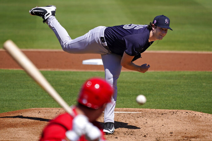 New York Yankees starting pitcher Gerrit Cole delivers to Philadelphia Phillies' Rhys Hoskins during the first inning of a spring training exhibition baseball game in Clearwater, Fla., Thursday, March 11, 2021. (AP Photo/Gene J. Puskar)