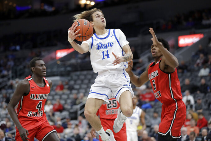 Drake's Noah Thomas (14) heads to the basket past Illinois State's Abdou Ndiaye (4) and Keith Fisher III (5) during the first half of an NCAA college basketball game in the first round of the Missouri Valley Conference men's tournament Thursday, March 5, 2020, in St. Louis. (AP Photo/Jeff Roberson)