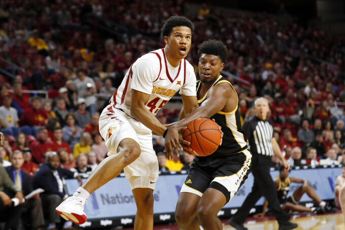 Iowa State guard Rasir Bolton is fouled by Southern Mississippi guard LaDavius Draine, right, while driving to the basket during the first half of an NCAA college basketball game, Tuesday, Nov. 19, 2019, in Ames, Iowa. (AP Photo/Charlie Neibergall)