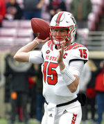 North Carolina State quarterback Ryan Finley (15) attempts a pass during the first half of an NCAA college football game, in Louisville, Ky., Saturday, Nov. 17, 2018. (AP Photo/Timothy D. Easley)