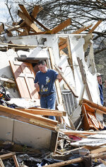 In this Tuesday, March 3, 2020 photo, Henry Watts works to remove debris from his home after a tornado ripped through the Stanford Estates Neighborhood near Donelson Christian Academy in Nashville, Tenn. (George Walker IV/The Tennessean via AP)