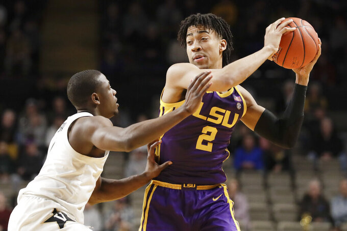 LSU forward Trendon Watford (2) is defended by Vanderbilt's Maxwell Evans, left, in the first half of an NCAA college basketball game Wednesday, Feb. 5, 2020, in Nashville, Tenn. (AP Photo/Mark Humphrey)