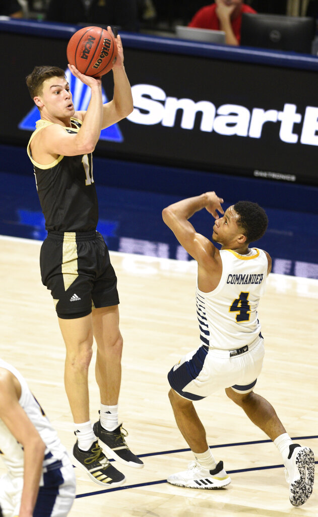 Wofford's Nathan Hoover (10) shoots over Chattanooga's Maurice Commander (4) during an NCAA college basketball game Wednesday, Jan. 15, 2020, in Chattanooga, Tenn. (Robin Rudd/Chattanooga Times Free Press via AP)