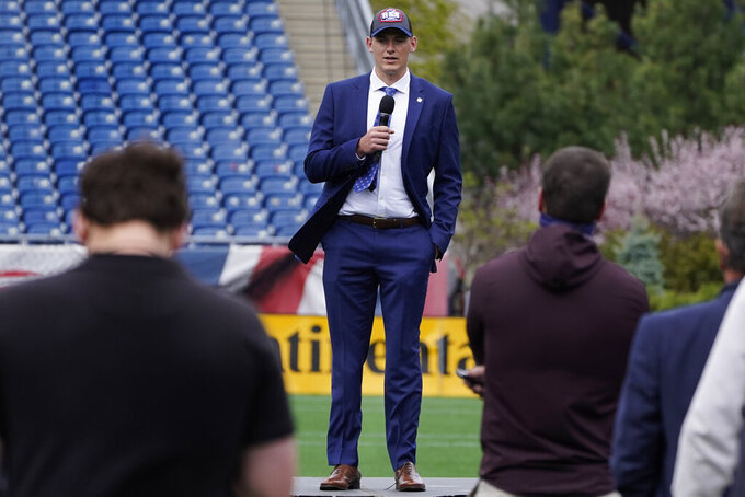 New England Patriots 2021 first-round draft pick, former Alabama quarterback Mac Jones addresses the media, Friday, April 30, 2021, in Foxborough, Mass. The Patriots selected Jones with the 15th pick in Thursday's NFL Draft. (AP Photo/Charles Krupa)