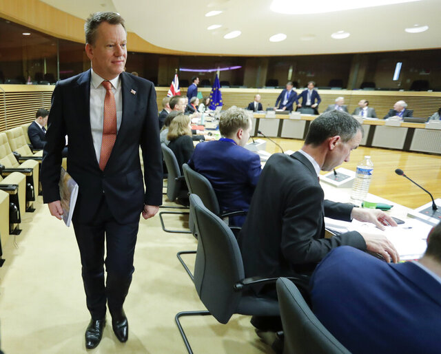 The British Prime Minister's Europe adviser David Frost, left, arrives for the start of the first round of post -Brexit trade talks between the EU and the UK, at EU headquarters in Brussels, Monday, March 2, 2020. Long-awaited trade talks between the EU and Britain kick off Monday amid deep tensions over Prime Minister Boris Johnson's threat to walk away from the talks if not enough progress is made within four months. (Olivier Hoslet. Pool Photo via AP)
