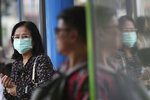 A pedestrian wears a face mask to filter dirty air, an action suggested by Prime Minister Prayuth Chan-ocha, in Bangkok, Thailand, Monday, Sept. 30, 2019. Many provinces of Thailand, including Bangkok, are shrouded with toxic smog Monday, causing concerns among people of much worst situation in the upcoming dry season when agriculture burning season really begins. (AP Photo/Sakchai Lalit)