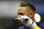 Milwaukee Brewers' Orlando Arcia puts the remains of his broken bat to his nose after grounding out during the sixth inning of a baseball game against the Pittsburgh Pirates, Sunday, Sept. 22, 2019, in Milwaukee. (AP Photo/Aaron Gash)