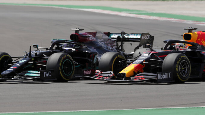 Red Bull driver Max Verstappen of the Netherlands tries to overtake Mercedes driver Lewis Hamilton of Britain, left, during the Portugal Formula One Grand Prix at the Algarve International Circuit near Portimao, Portugal, Sunday, May 2, 2021. (AP Photo/Manu Fernandez)