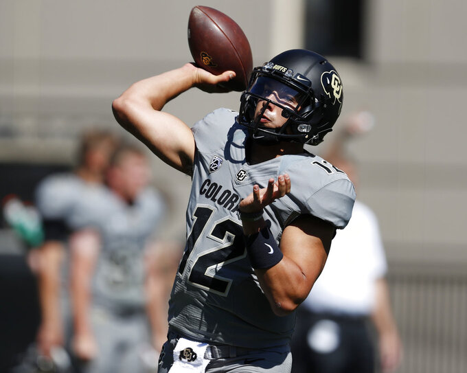 Colorado quarterback Steven Montez warms up before an NCAA college football game against New Hampshire Saturday, Sept. 15, 2018, in Boulder, Colo. (AP Photo/David Zalubowski)