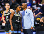 Chicago Sky coach James Wade talks to Dana Evans as she enters the team's WNBA basketball game against the Seattle Storm on Friday, Aug. 27, 2021, in Everett, Wash. (Dean Rutz/The Seattle Times via AP)