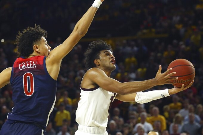 FILE - In this Jan. 25, 2020, file photo, Arizona State guard Remy Martin, right, drives past Arizona guard Josh Green (0) to score during the second half of an NCAA college basketball game in Tempe, Ariz. Arizona State is the Pac-12's highest-ranked team in the AP preseason poll at No. 18, gets Martin back and has arguably the best recruiting class in program history. (AP Photo/Ross D. Franklin, File)